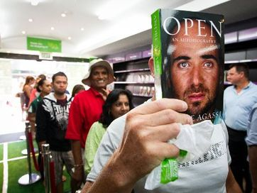 Fans queue for tennis great Andre Agassi signing copies of his autobiography, entitled Open, at at Paper Plus in Newmarket, Auckland.