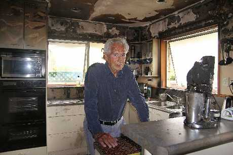 SCORCHED: Eric Bell in the fire-damaged kitchen of his Casebrook home.