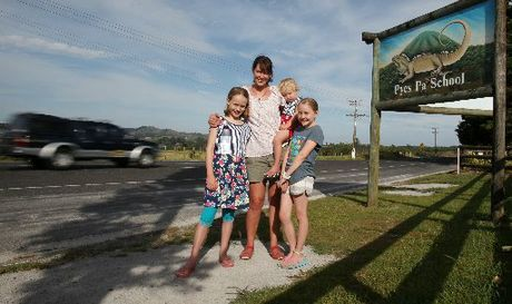 Ella (left), Lorna and Lucy Claydon and Rose Mayhead outside Pyes Pa School where variable speed limit signs are going in.PHOTO/JOEL FORD