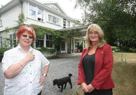 PERFECT: Real estate agent Deb Keats (right) is selling the million-dollar house, Woodchester. She is pictured with owner Liz Greville outside the entrance.