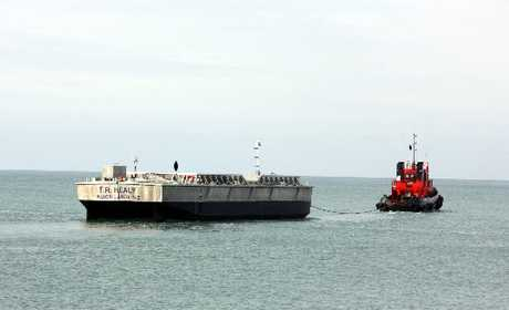 PLAIN SAILING: This 40m barge, under tow to its new home in Auckland, is the biggest vessel to leave the Q-West boatyard in Castlecliff. Its sailing signals a productive year ahead for the Wanganui company.