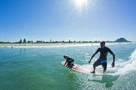 Craig Anderson and son Marvin enjoying a surf at Mount Maunganui.