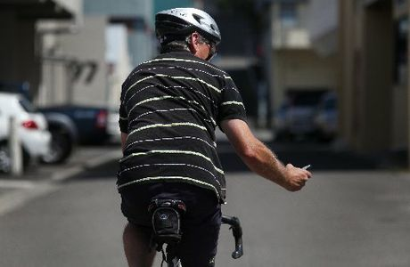 Police say texting while on a bike is illegal. Cyclists caught texting while riding faced an $80 fine and 20 demerit points. (Staged photo)