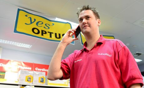 Hardware manager David Roberts at Harvey Norman Rockhampton had full service on his optus phone during the Telstra outage. The big wet, Australia Day weekend in Rockhampton 2013. Photo Sharyn O'Neill / The Morning Bulletin