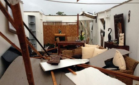 SUDDEN DEVASTATION: This home had its roof torn off when a tornado slammed onto the coast at Burnett Heads. Photo: Max Fleet / NewsMail
