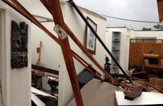SUDDEN DEVESTATION: This home had the roof torn off when a tornado slammed onto the coast at Burnett Heads. Photo: Max Fleet / NewsMail