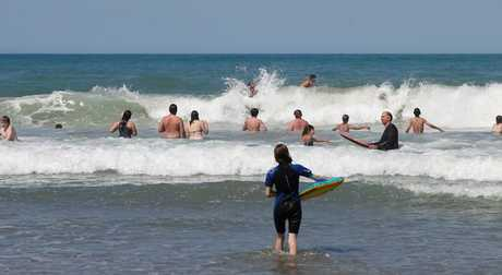 Sunny hot weather in the school holidays brings out the crowds at Waimarama Beach, Waimarama.
