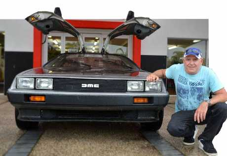 RIGHT-HAND MAN: Gympie businessman and car enthusiast Greg Waters with his classic DeLorean sports car.