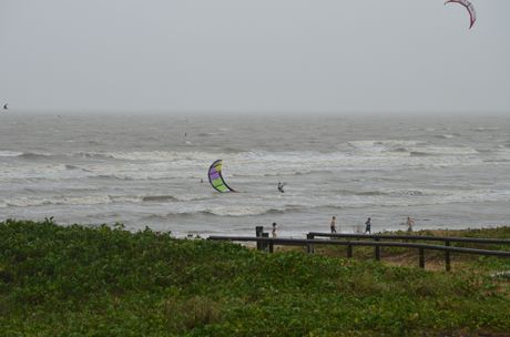 Tannum Sands beach being closed hasn't stopped kite surfers using the wind to their advantage.