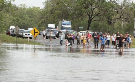 Motorists stranded on the Maryborough side of Saltwater Creek on the Bruce Highway. Photo: Robyne Cuerel / Fraser Coast Chronicle