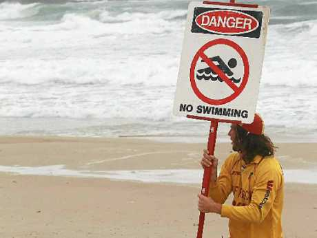 WILD AND WINDY: Metropolitan Caloundra patrol captain Cameron Smith makes sure swimmers stay out of the water at Kings Beach, Caloundra.
