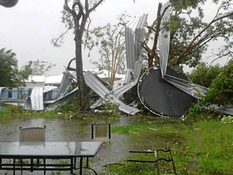 WILD WEATHER: A ute (left) sits suspended and (right) the remnants of a shed blown into a neighbour's yard during a tornado.