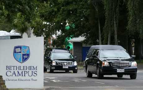 FINAL JOURNEY: Two hearses leave Bethlehem College following the funeral for Brian and Grace Johnston.