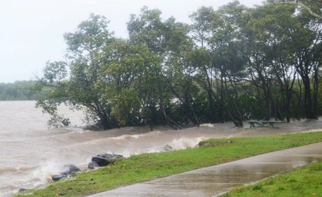 A picnic table goes under as flood water rise in Tweed Heads South on Monday, January 28, 2013.