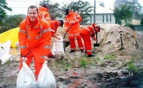 SES worker Peter Koplick joins fellow volunteers at the Daisy Hill Depot in filling sandbags to help local residents fight this weeks flood. Photo: Chris Owen / The Satellite Photo: Chris Owen / The Reporter