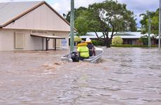 MASS EVACUATION: Emergency services and volunteers work hard and in dangerous waters to evacuate residents of North Bundaberg. Photo: Scottie Simmonds / NewsMail