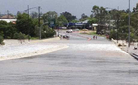 NO GO: Flooding closes the road at One Mile.