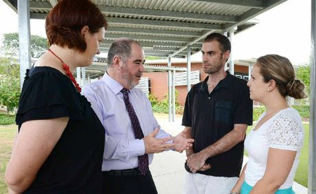 HOMEWORK: Queensland Teachers' Union state president Kevin Bates (second from left) speaks with Bundamba Secondary College teacher Susan Sherlock, Redbank Plains S.H.S teacher Andrew Stratton and Bremer S.H.S Year 8 co-ordinator Kelly Ling.