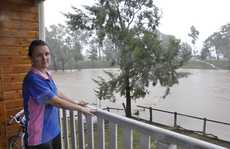 Oakey resident Marsha Donovan watches Oakey Creek from her verandah.
