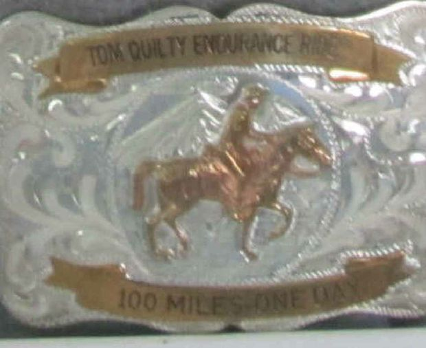 Dick won the right to wear the coveted belt buckle after his first Tom Quilty ride in 1994.