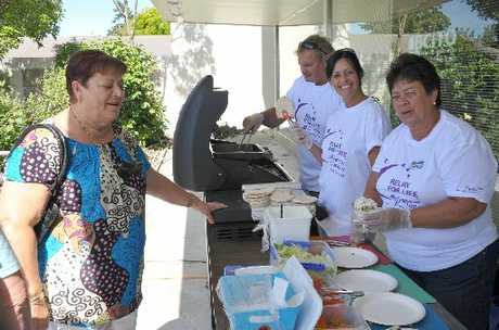 GOOD CAUSE: Irene Davidson, from Masterton, waits for her lamb and pita bread treat served up by Steve Borrell, Jo Borrell and June Zaloumis at the Tranzit fundraiser for Relay for Life. 