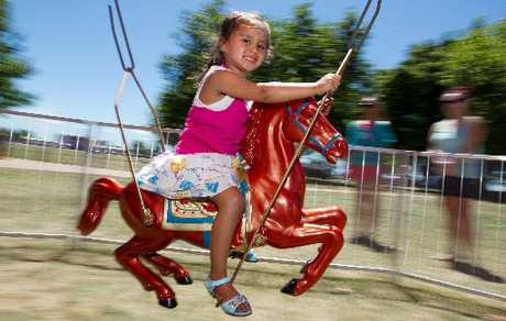 LONG WEEKEND: Rotorua's Barbara-Jae Popata, 4, had a ball on the merry-go-round at the lakefront yesterday.