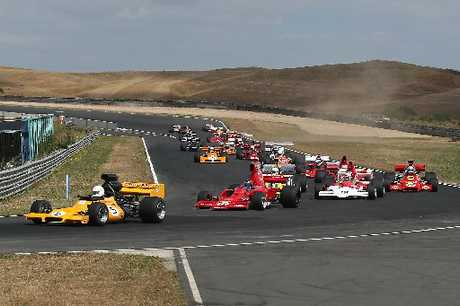 The F5000s (above), Can-Ams and the grunty V8 muscle cars thrilled the huge crowds.