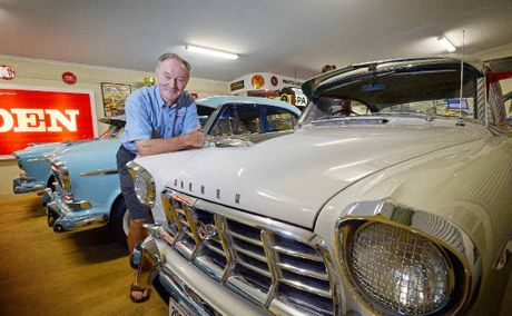 STEP INTO MY SHOWROOM: Car lover Kevin Woolard of Ewingsdale in his shed converted into a car dealership.