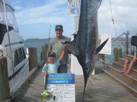 Seven-year-old Hunter Scott lands a whopper marlin and possibly a sport fishing record too.