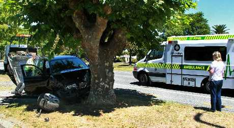 SUDDEN STOP: A 77-year-old Havelock North man escaped serious injury after  a late-model BMW wagon hit two trees about 2pm on Georges  Drive, Napier,  yesterday. PHOTO/WARREN BUCKLAND HBT130525-03