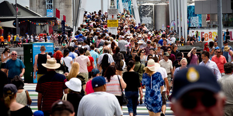 Large crowds move along the city waterfront during Auckland Anniversary weekend.