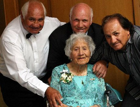 Mary Going surrounded by sons, from left Ken, Sid and Brian during her 100th birthday celebrations.