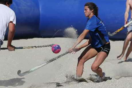 Amy Robinson of the Blue Steel team challenges for the ball at the NZ Beach Hockey Championships final held at the Mount Main Beach. Photo / Joel Ford