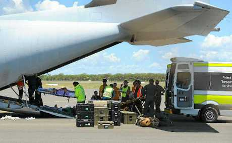 Patients from Bundaberg Hospital are loaded into the Hercules aircraft to be airlifted to Brisbane.