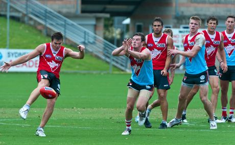 Sydney Swans utility Craig Bird gets a kick away during Wednesday morning's open training session at BCU International Stadium. Picture: Rob Wright / Coffs Coast Advocate