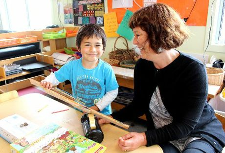 CREATIVE KIDS: Four-year-old Romeo Harris shows Oamaru Little Wonders Early Childhood Centre head teacher Pip Cleverley his creations. PHOTO/REBECCA RYAN