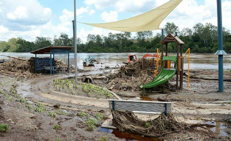 HEARTBREAK: The Queensland Fire and Rescue Service helped with the flood clean-up at Colleges Crossing yesterday.
