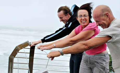 HOLD ON TIGHT: It was wild weather in Ballina on Monday with extremely strong winds, and Bill, Mary and Dom Howard, from Ballina, had to hang on tight as they checked out the view from Lighthouse Lookout in Ballina.