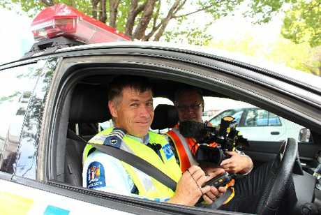 HOT COP: Shay Dewey (right), TV cameraman, followed Oamaru police Highway Patrol Sergeant Peter Muldrew around on his day-to-day routine yesterday, filming for a second series of Highway Cops.