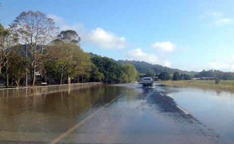 Cars on the Tweed Valley Way driving through flood water.