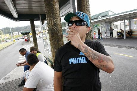 Zane Tito having a smoke at a bus stop, which will soon be smoke-free. Photo / Michael Cunningham