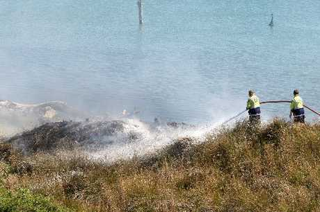 EXTREME RISK: Firefighters battle a blaze in dry vegetation beside the Whanganui River estuary on Monday. PICTURE / BEVAN CONLEY