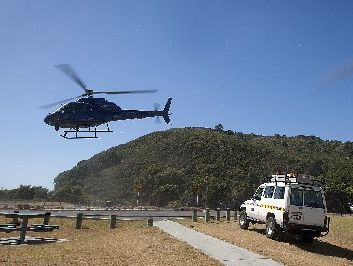 The police helicopter leaves Waihi Beach in search of the missing boatie. Photo / Andrew Warner