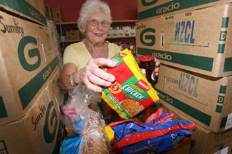 IN NEED: Masterton Food Bank volunteer Linda Bouton packs a food parcel. PHOTO/LYNDA FERINGA