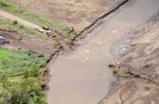 Council crews are working tirelessly to open up roads across the flood-devastated Mt Sylvia region.