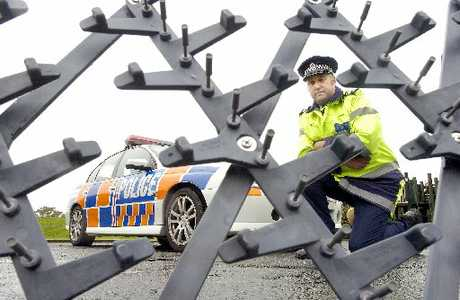 SPIKED: Police road spikes. A teenager drove for 2km after his tyres were deflated by the spikes.