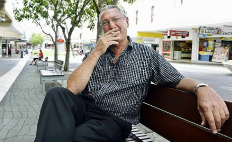 LAST GASP: Cr Charlie Pisasale enjoys a final cigarette in the Ipswich Mall yesterday.