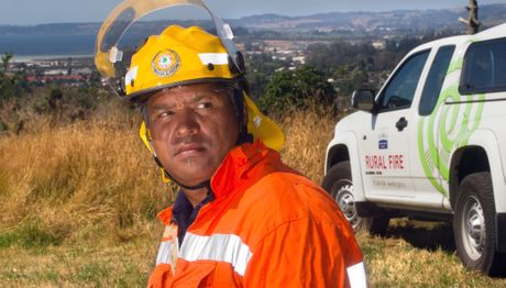Rural fire officer John Reihana inspects the dry conditions that have led to a total fire ban in Rotorua. Photo / Stephen Parker 