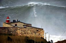Surfer Garrett McNamara, 45, rides this wave, said to be a world-record 30m, off Praia do Norte beach in Nazare, Portugal.