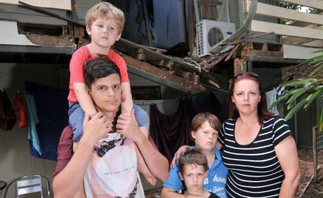 Michelle Sadlier with Jake, 19, Jesse, 4, Brodie, 6, and Lachlan, 11, outside their wrecked rental house at Mooloolah.